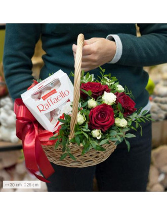 Basket with flowers and chocolates